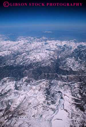 Stock Photo #7167: keywords -  aerial barren batholith california cold elevate elevated environment granite horizon icy landscape mountain mountains nature relief rough rugged sierra snow terrain vert wild wilderness winter