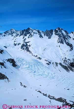 Stock Photo #7219: keywords -  aerial alaska alpine bay clean climate cold desolate desolation environment field freeze freezing frozen geologic geological geology glacier hostile ice icy inhospitable landscape mount mountain mountains mt. national nature outdoor park peak peaks precipitation pristine pure range relief rock rocks rugged scenery scenic slope sloping snow steep summit terrain vert weather wild wilderness