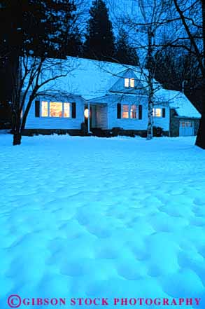 Stock Photo #7236: keywords -  building climate climatology cold dusk freeze freezing frozen home ice icy light lighting lights lit mood nature precipitation released residence residential season snow vert warm weather winter