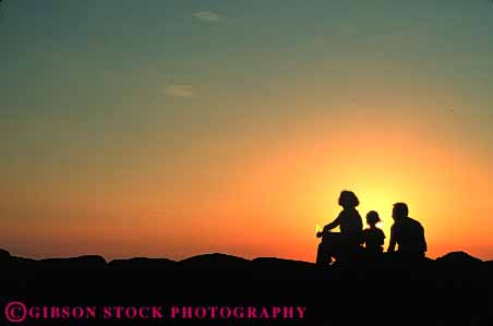 Stock Photo #7327: keywords -  child children dawn dusk evening family father horz husband kid mood moody morning mother nature parent parents people resort share silhouette silhouettes social sun sunrise sunset together vacation warm wife