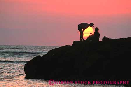 Stock Photo #7328: keywords -  affection caring couple dawn dusk evening horz intimacy intimate love lover lovers loving man mood moody morning nature near ocean people picnic privacy private romantic share silhouette silhouettes social sun sunrise sunset together warm woman