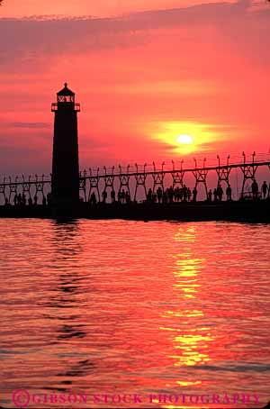 Stock Photo #7336: keywords -  building buildings dusk evening grand haven house lake light lighthouse manmade michigan mood moody orange red resort silhouette silhouettes structure summer sun sunrise sunset tower travel vacation vert warm water