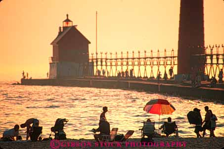 Stock Photo #7338: keywords -  beach building buildings dawn dusk evening grand haven horz house lake landscape light lighthouse manmade michigan mood moody orange people red resort scenery scenic silhouette silhouettes structure summer sun sunrise sunset tower travel vacation warm water