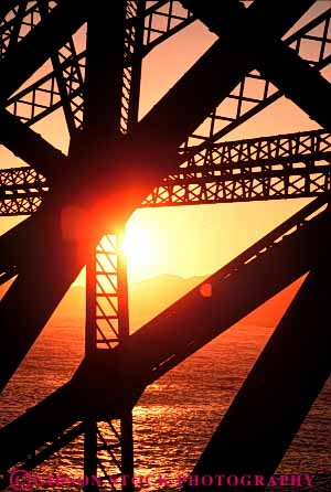 Stock Photo #7342: keywords -  brace braces bridge building buildings california dawn design dusk engineer engineering evening francisco gate geometric geometrical geometry golden grid iron manmade metal mood moody morning san silhouette silhouettes steel structure sun sunrise sunset supports triangle triangles vert warm