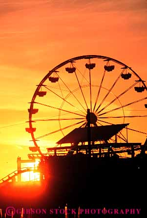 Stock Photo #7345: keywords -  amusement building buildings california circumference dawn dusk evening fair ferris festival landscape manmade monica mood moody morning park pier play radius resort ride rotate rotates rotating rotation round santa scenery scenic silhouette silhouettes structure sun sunrise sunset travel vacation vert warm wheel