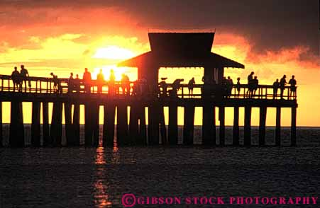 Stock Photo #7347: keywords -  building buildings coast coastal dawn dusk evening fish fisherman fishing florida horz manmade mood moody morning naples ocean people pier recreation resort sea seascape shore shoreline silhouette silhouettes structure sun sunrise sunset travel vacation warm