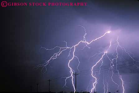 Stock Photo #7436: keywords -  arc bolt bright climate cloud clouds dark dawn dusk electric electrical electricity environment evening flash horz lightening lightning morning nature night precipitation rain rainy spark sparks storm threaten threatening voltage weather
