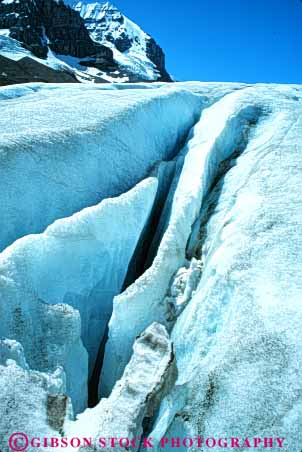 Stock Photo #7473: keywords -  alberta athabasca canada climate cold crack cracked cracks crevasses environment freeze freezing frozen glacial glacier glaciers habitat ice icy jasper landscape mountain mountains national nature park scenery scenic snow vert weather winter