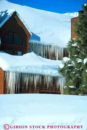 Stock Photo #7056: keywords -  chill chilly cold environment eve freeze freezing frozen hanging home homes house ice icicle icicles icy nature season snow vert water wet winter