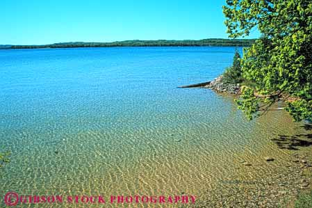 Stock Photo #7093: keywords -  beautiful beauty calm clean clear environment freshwater horz lake landscape leelanau michigan nature peaceful pond pretty pristine pure quiet remote runoff scenery scenic shallow shore solitude still summer water wet wild wilderness