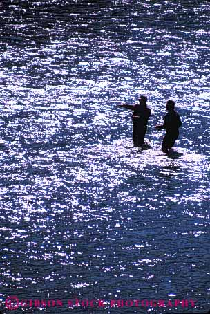 Stock Photo #5535: keywords -  catch creek fish fisherman fishermen fishing glare men outdoor outdoors outside recreation reflection ripple ripples river share silhouette sport stream team together two vacation vert water