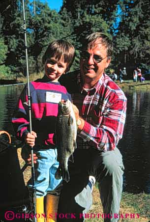 Stock Photo #5537: keywords -  boast boasting boasts boy catch caught dad father fish fisherman fishermen fishing man outdoor outdoors outside pride proud recreation released son sport team trout vert water