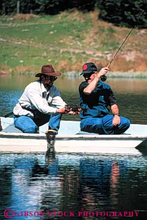 Stock Photo #5540: keywords -  boat catch caught fish fisherman fishermen fishing guide lake land landed men outboard outdoor outdoors outside pond recreation released small sport summer trout vert water