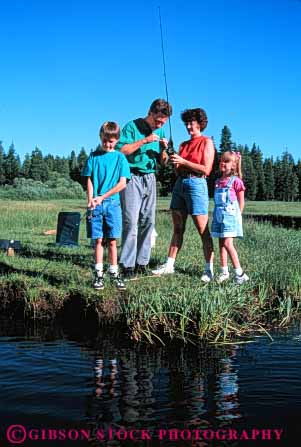 Stock Photo #5544: keywords -  assist boy brother catch colorful cooperate family fish fisherman fishermen fishing four girl help husband man outdoor outdoors outside recreation released share sibling sister sport stream summer team together vacation vert water wife woman