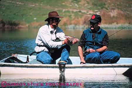 Stock Photo #5549: keywords -  achieve achievement boat catch caught display fish fisherman fishermen fishing guide hold horz lake land landed man motorboat outdoor outdoors outside pond recreation released small sport success successful summer team trout water