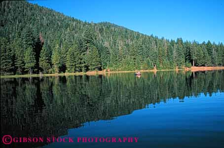 Stock Photo #5551: keywords -  alone calm catch fish fisherman fishermen fishing float floating forest horz lake man outdoor outdoors outside peaceful private quiet recreation reflection released serene solitude sport summer symmetry tree trees water