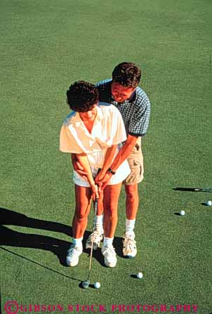 Stock Photo #3535: keywords -  affection assist close couple game golf help hug husband learn man putt recreation released sport sports teach together vert white wife woman