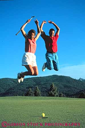 Stock Photo #5553: keywords -  air ball born club country couple course express expression glee golf golfer golfers golfing grass green happy husband joy jump lawn leap man outdoor outdoors outside practice recreation released share skill sport spouse summer thrill together vert wife woman
