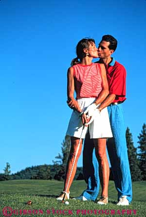 Stock Photo #5555: keywords -  affection club country couple course golf golfer golfers golfing grass green hug husband intimate kiss lawn outdoor outdoors outside practice recreation released share skill smooch sport spouse together vert wife