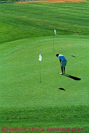 Stock Photo #5557: keywords -  alone club concentrate concentration country course golf golfer golfers golfing grass green lawn man outdoor outdoors outside practice private putting quiet recreation serene skill solitary solitude sport summer vert