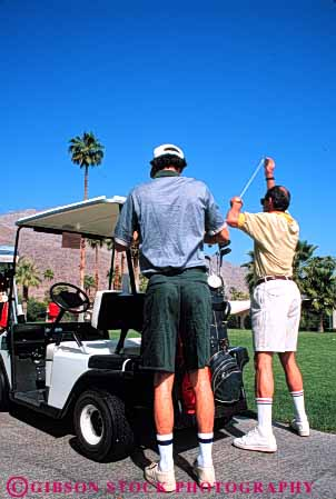 Stock Photo #5561: keywords -  ca california cart club country course desert golf golfer golfers golfing grass green lawn outdoor outdoors outside palm practice recreation resort skill sport springs summer vacation vert