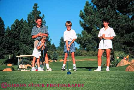 Stock Photo #5564: keywords -  brother club country course daughter family father four golf golfer golfers golfing grass green horz husband lawn learn mother outdoor outdoors outside parent parents practice recreation released share sibling sister skill son sport spouse summer together wife
