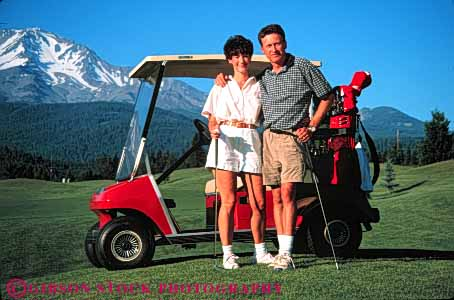Stock Photo #5565: keywords -  affection california club country couple course embrace golf golfer golfers golfing grass green happy horz lawn mt outdoor outdoors outside pause portrait pose practice recreation relax released resort share shasta skill sport summer team together travel vacation
