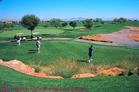Stock Photo #5569: keywords -  club country course golf golfer golfers golfing grass green horz las lawn nv off outdoor outdoors outside practice recreation resort skill sport summer summerlin tee vegas