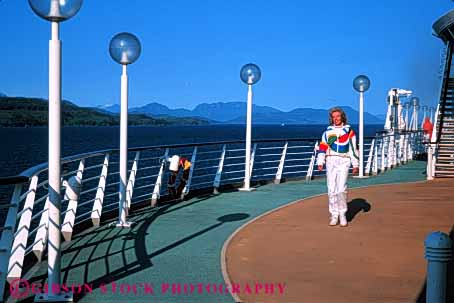 Stock Photo #5590: keywords -  along calm cruise elderly exercise exercising explore female fit fitness he hiking horz invigorate invigorating mature move of outdoor outdoors outside peaceful physical physically quiet released rhapsody seas senior ship solitary solitude stroll walk walker walking woman workout