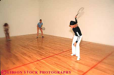 Stock Photo #5656: keywords -  action activity ball compete competing competition competitive competitor court edges female group gym gymnasium horz indoor indoors loose photowsport play racket racketball recreation soft sports win woman women young