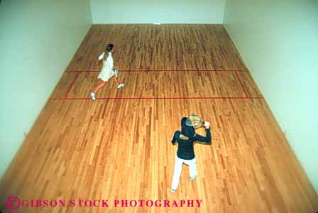 Stock Photo #5657: keywords -  action activity ball compete competing competition competitive competitor court edges female group gym gymnasium horz indoor indoors loose photowsport play racket racketball recreation soft sports win woman women young