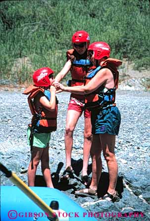 Stock Photo #5664: keywords -  adventure boat boater boating check child children daughter daughters equipment expedition family float flotation gear girl girls group helmet inflatable inflate jacket life material mother outdoor outdoors outside paddle paddler paddlers paddling parent parents plastic raft rafting recreation red released rubber safety single sister sisters sport sports stream summer synthetic team thrill travel trip vacation vert vest water