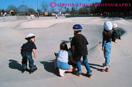 Stock Photo #5690: keywords -  adolescence adolescent adolescents blade boot boots california cement child children concrete equipment fall feet foot fun gilder glide gliding gravity group horz leg legs move movement outdoor outdoors outside park play practice protect protection recreation redding roll roller rollerblade rollerblader rollerblading rollerskater rollerskating rolling safety shoe shoes skate skill sport sports summer team terrain together wheel wheels youth youths