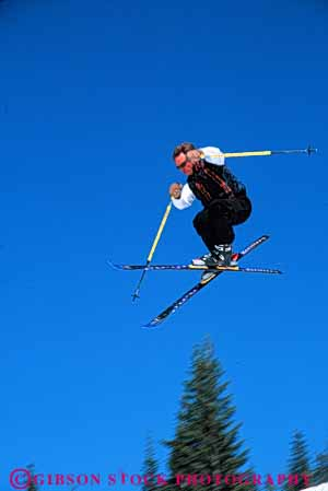 Stock Photo #5697: keywords -  action air born cold downhill gravity high jump leap man outdoor outdoors outside recreation resort season ski skier skiers skiing sky snow sport sports stop style vert winter
