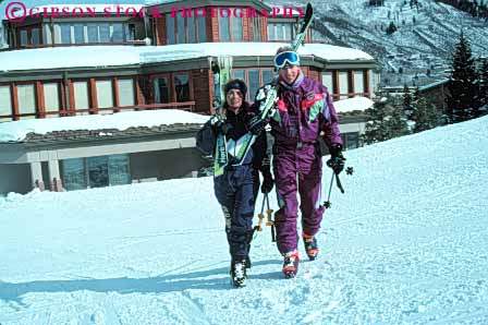 Stock Photo #5703: keywords -  aspen cold colorado couple downhill equipment horz husband man outdoor outdoors outside portrait recreation released resort season share ski skier skiers skiing snow sport sports team together travel trip two vacation walk wife winter woman