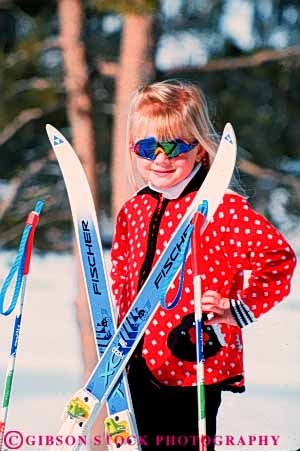 Stock Photo #5704: keywords -  blond child children cold color colorful cute daughter downhill equipment face girl outdoor outdoors outside pose pretty recreation released resort season ski skier skiers skiing smile snow sport sports sunglasses travel trip vacation vert winter