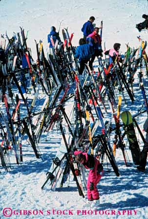 Stock Photo #5708: keywords -  cold confuse confusing congestion downhill equipment loose lost lots many misplace multitude outdoor outdoors outside pile rack recreation resort same season ski skier skiers skiing snow sport sports storage store travel trip vacation vert winter