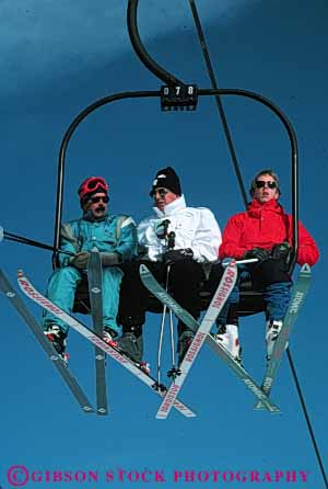 Stock Photo #5710: keywords -  carry cold downhill equipment lift lifting men move outdoor outdoors outside portrait pose recreation resort ride season ski skier skiers skiing snow sport sports three transport travel trip uphill vacation vert winter