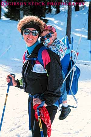 Stock Photo #5712: keywords -  baby backpack balance carry child children cold downhill effort equipment happy infant load mother outdoor outdoors outside pack parent portrait pose recreation released resort season single ski skier skiers skiing smile snow sport sports travel trip vacation vert winter