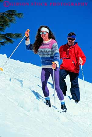 Stock Photo #5729: keywords -  adventure cold color colorful country couple cross crosscountry equipment exercise explore husband man nordic outdoor outdoors outside recreation released resort season share ski skier skiers skiing snow sport sports together travel trip vacation vert wife winter woman