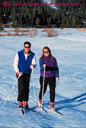 Stock Photo #5731: keywords -  adventure cold country couple cross crosscountry equipment exercise man nordic outdoor outdoors outside recreation released resort season ski skier skiers skiing snow sport sports travel trip two vacation vert winter woman