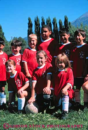 Stock Photo #5761: keywords -  active ball boys child children coed compete competing competition competitor cooperate cooperating cooperative coordinate effort ethnic exercise fitness gender girls goal kick middle mixed physical plan ran recreation run runner running school soccer social sport team uniform uniforms vert workout youth