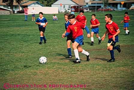Stock Photo #5773: keywords -  action active ball boys child children compete competing competition competitor cooperate cooperating cooperative coordinate effort exercise fitness goal horz kick middle physical plan ran recreation run runner running school soccer social sport team uniform uniforms workout youth
