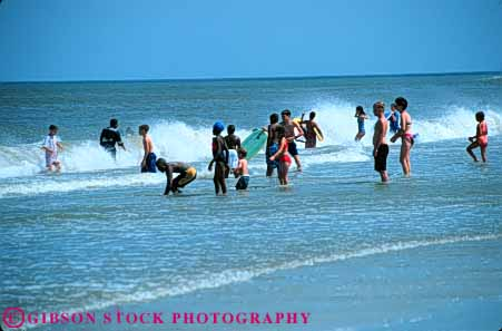 Stock Photo #5794: keywords -  adolescent adolescents african american beach black children cool ethnic fl florida horz jacksonville minority mixed ocean outdoor outdoors outside play recreation refresh refreshing sea sport summer surf swim swimmer swimmers swimming warm water wet
