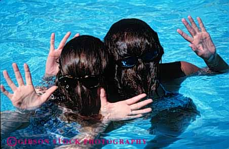 Stock Photo #5807: keywords -  cool cute different face fun funny girls hair head horz outdoor outdoors outside play pool recreation refresh refreshing sport summer swim swimmer swimmers swimming warm water wet