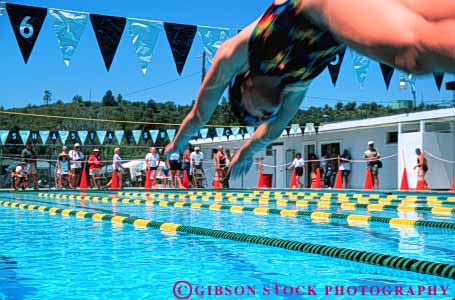 Stock Photo #5819: keywords -  action blur challenge compete competing competition competitor contest dive effort exertion girls horz move movement moving outdoor outdoors outside pool race recreation side speed sport start summer swim swimmer swimmers swimming water wet winner