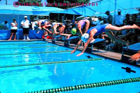Stock Photo #5820: keywords -  action blur challenge compete competing competition competitor contest dives dynamic effort exertion girls horz move movement moving outdoor outdoors outside pool race recreation side speed sport start summer swim swimmer swimmers swimming water wet winner
