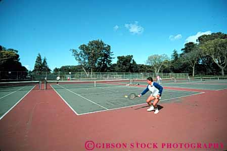 Stock Photo #5825: keywords -  agility backhand ball court exercise game hit horz man match motion move movement moving net opponent opposition outdoor outdoors outside pair play playing racket racquet rebound recreation run sport summer swing tennis vitality workout