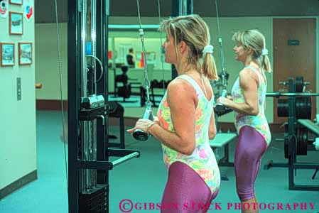 Stock Photo #5837: keywords -  aerobic develop equipment exercise female gym health horz indoor machine move movement muscle power recreation released repetition sport strength strengthen strong training weight woman workout