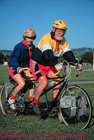 Stock Photo #5852: keywords -  balance bicycle bicycling bike colorful couple elderly exercise helmet helmets human husband mature old peddle power recreation released ride roll senior seniors sport steer tandem together transportation two vert wheel wheels wife